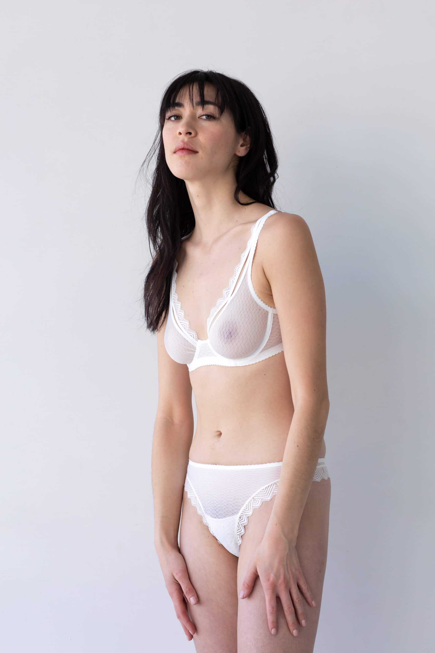 Lonely Misha High Waist Thong in sheer white lace, front/side view on model in matching underwire bra