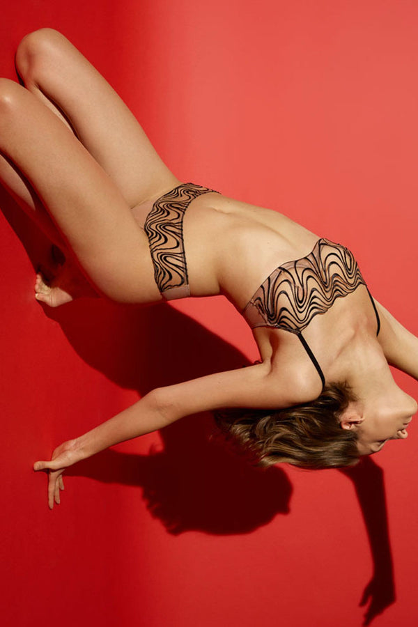 Noelle Wolf Mist Embroidered Bandeau Bra and Thong on Model in a backbend pose, front view, on red background