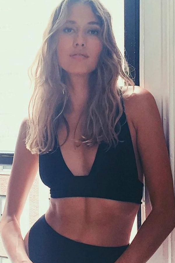 Only Hearts Eco Rib Banded bralette in black, front view, on model also wearing the matching high waist brief