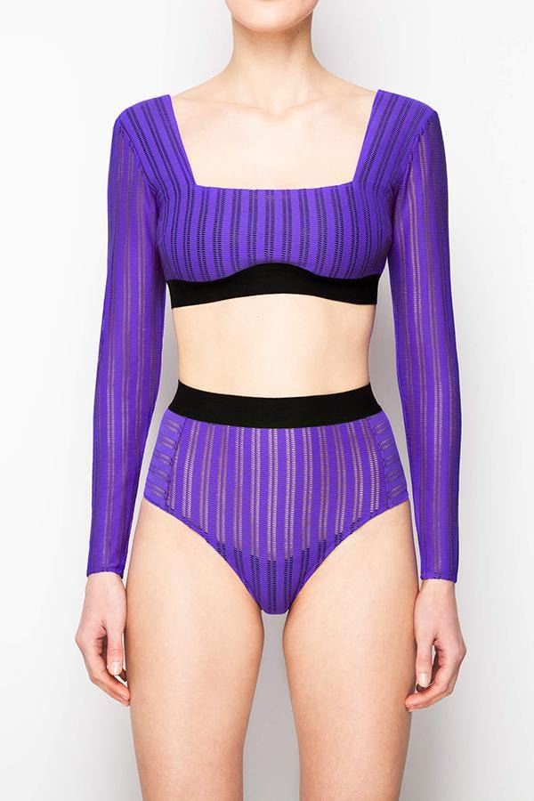 Opaak Fey High Cut Brief in bright ultra violet purple. Shown on model, facing forward, also wearing the matching long sleeved crop top.