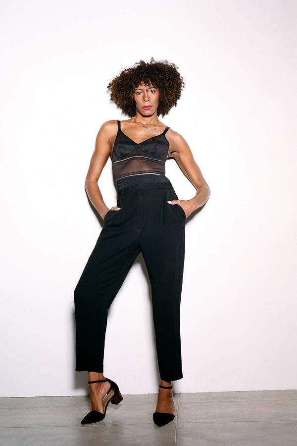 Opaak Lux bodysuit in black, front view on model