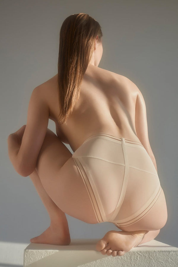 Opaak Paloma high waist brief in sheer light beige (bleached sand), back view, on model