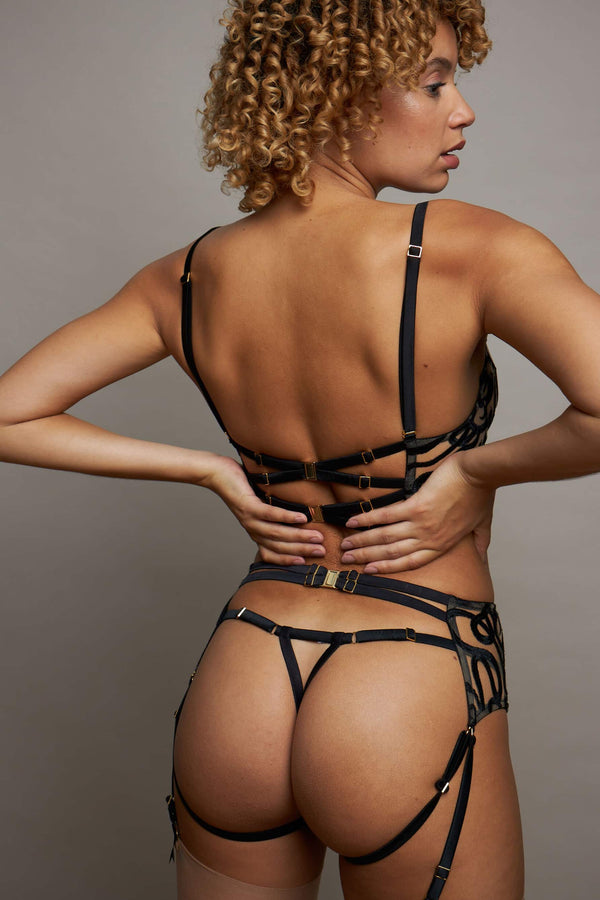 Studio Pia Naga strap thong, harness suspender brief and longline bra, back view on model