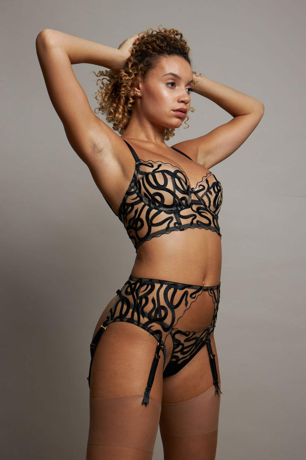 Studio Pia Naga sheer snake embroidered longline bra, harness suspender, and strap thong, side/front view on model