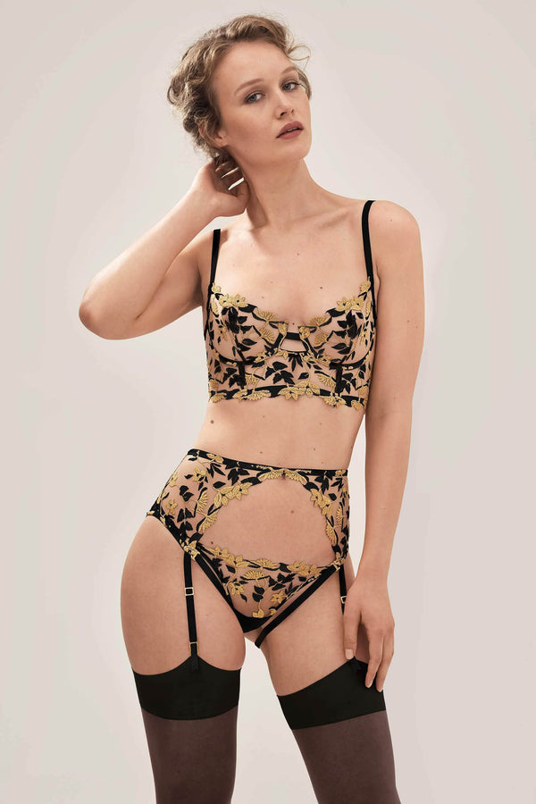 Studio Pia Soraya Longline Balconette Bra in Gold & Black Embroidery, back view, on model. Front full body view shown with matching thong and harness suspender