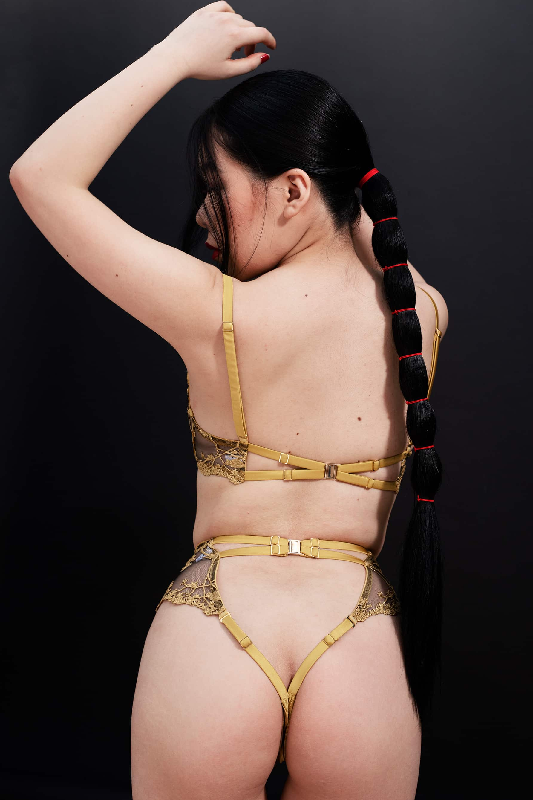 Yuna High Waist Thong by Studio Pia in black tulle with gold embroidery, back view on model