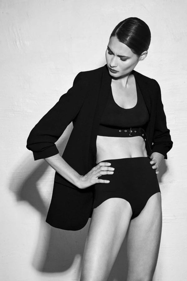 Ruban Noir High Waist Panty/swim bottom in black, front/side view, shown on model wearing a jacket and crop top
