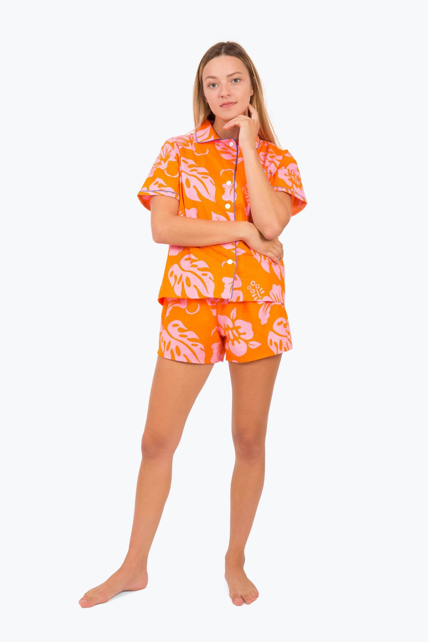 Sleepy Jones Aloha orange and pink Hawaiian print cotton pajama set with short sleeves and shorts, front view, on model