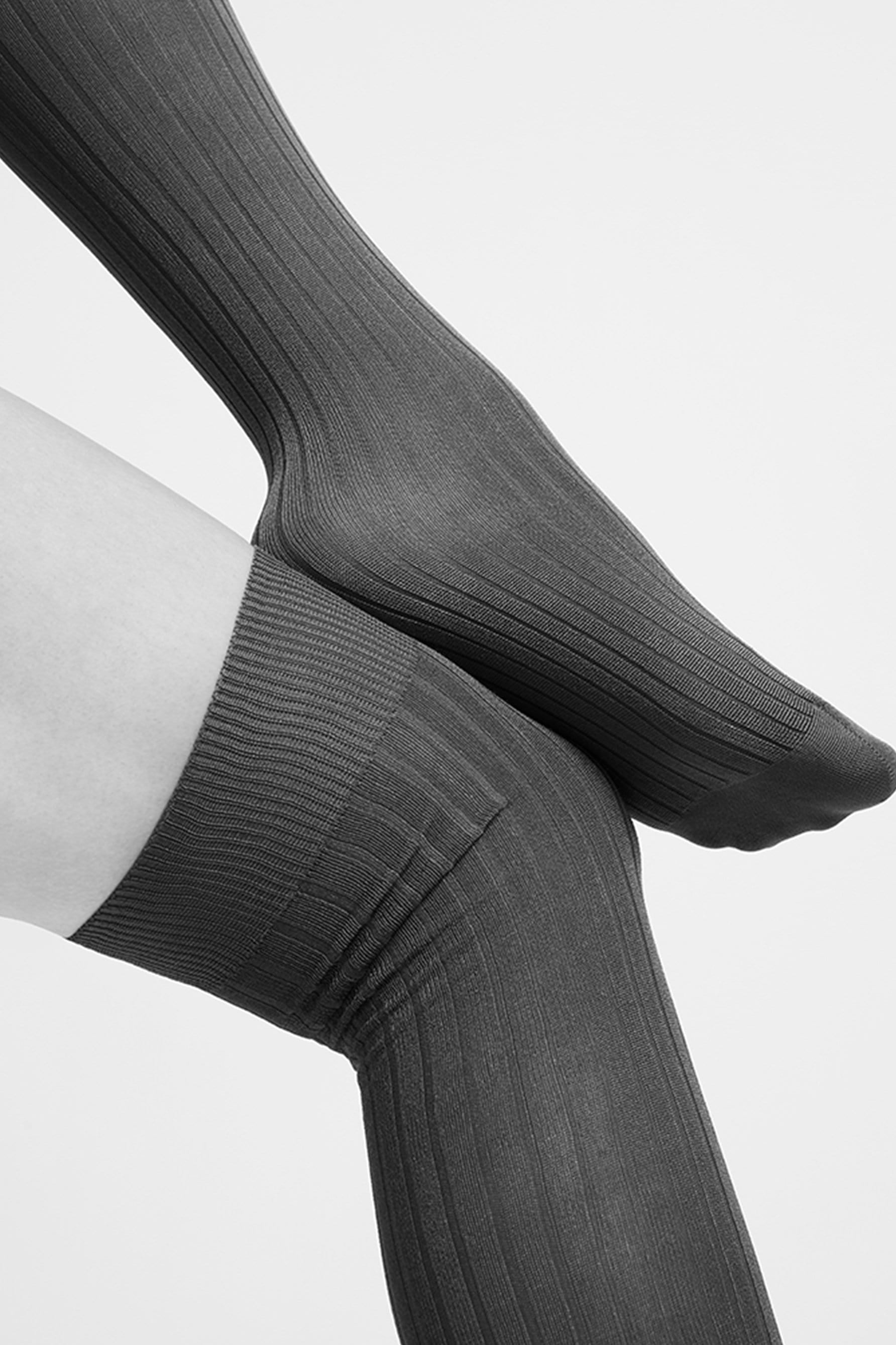 Swedish Stockings Ella over the knee ribbed socks in black, side view, shown on model, black and white photo