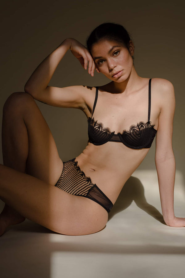 Taryn Winters Camille Lace Demi Bra in black pinstripe scalloped lace and matching thong, front/side view on model