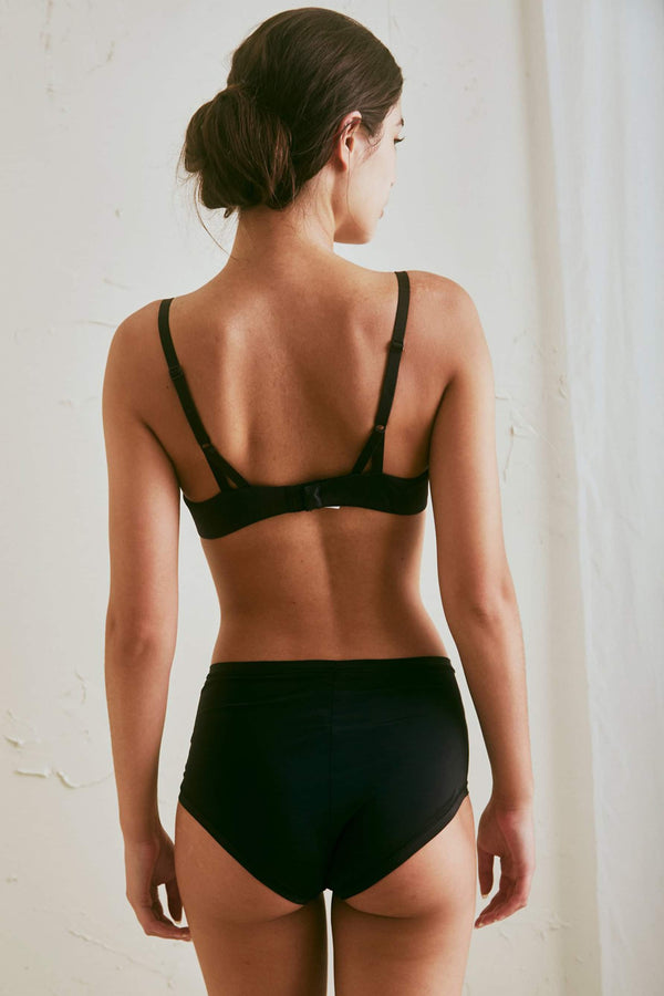 The Great Eros Lugano High Waist Brief in black, shown on model, back view