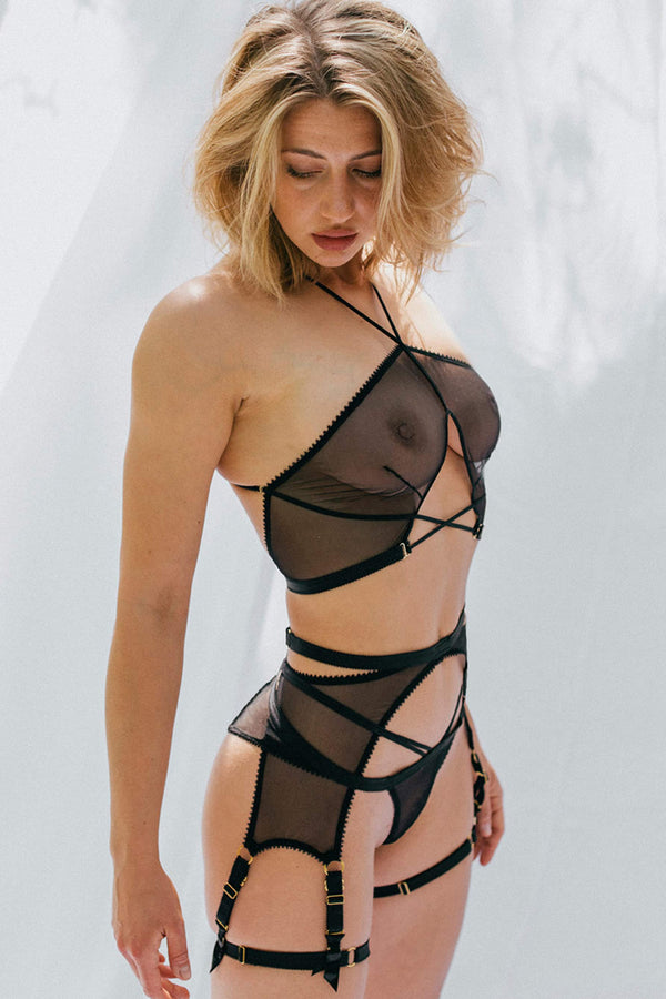 Tisja Damen Myth Longline Suspender harness in black mesh, side view, shown on model in matching halter bra, brief, and leg straps