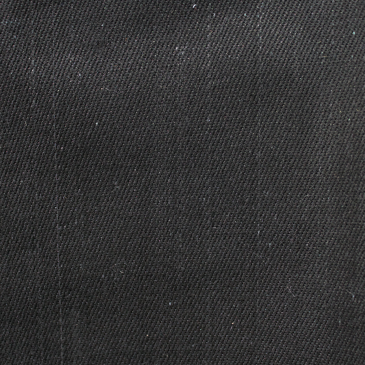 Black handwoven selvedge denim fabric with red selvedge line