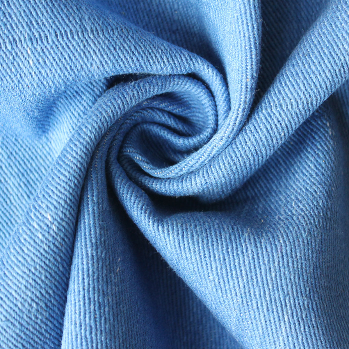 Light blue indigo selvedge denim fabric close up