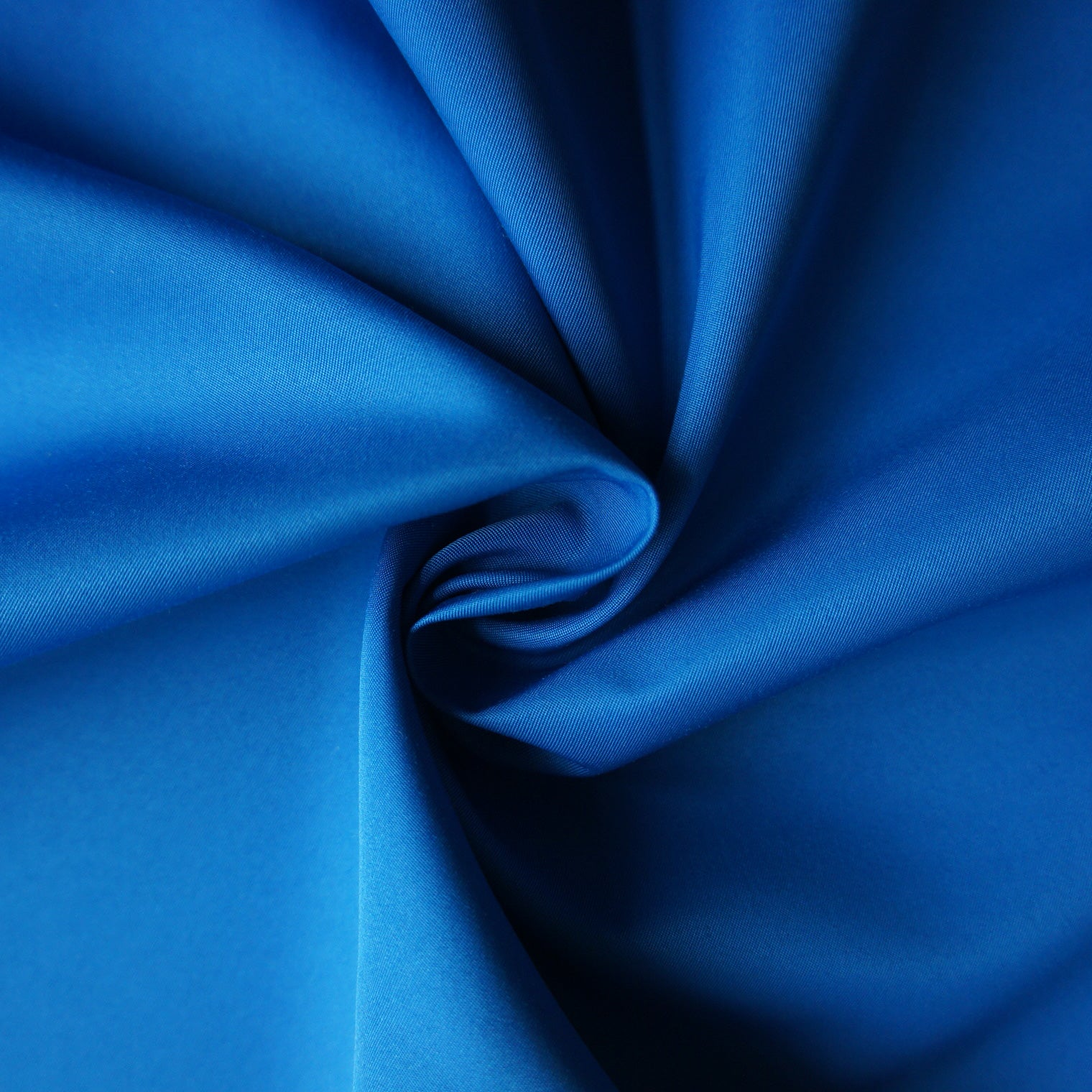 Blue recycled polyester satin fabric, twisted to show the drape