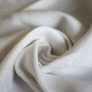 Textured White Fabric With Woven Decoration