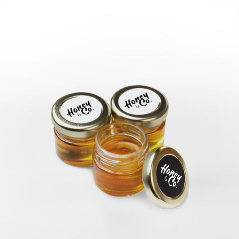 Cute Extra Mini glass jars of RAW Honey.