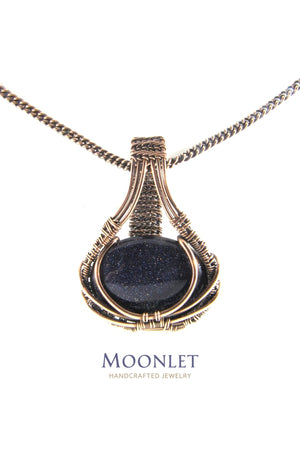 by MOONLET HANDCRAFTED JEWELRY Blue Goldstone Oval Antique Copper Pendant Necklace Wire Wrap Jewelry