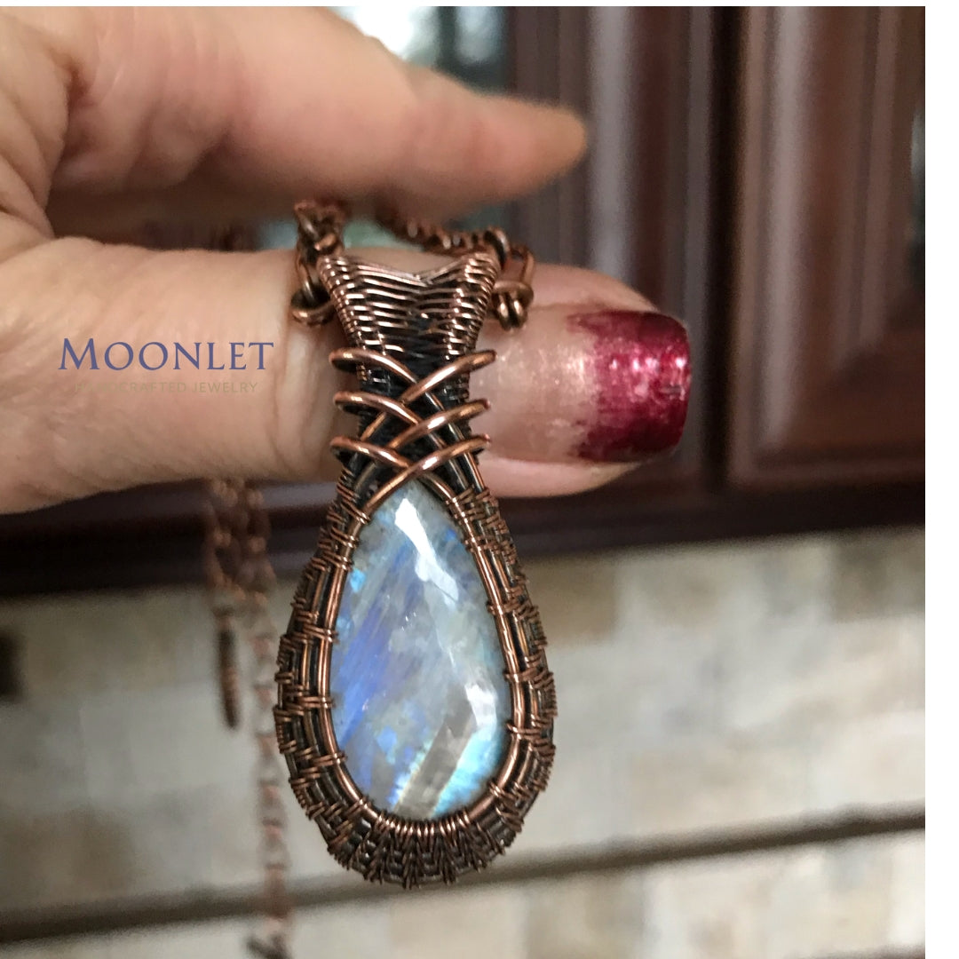 by MOONLET HANDCRAFTED JEWELRY Rainbow Moonstone Criss Cross Antique Copper Pendant Necklace Wire Wrap Jewelry