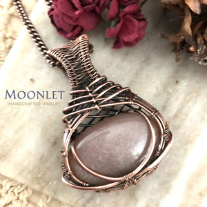 by MOONLET HANDCRAFTED JEWELRY Peach Moonstone Antique Copper Pendant Necklace Wire Wrap Jewelry