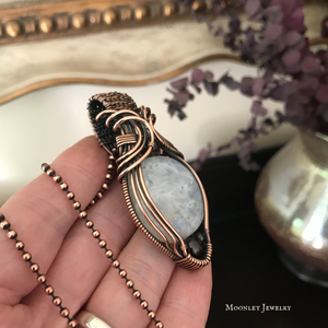 Round Moonstone with Garnet in Antique Copper
