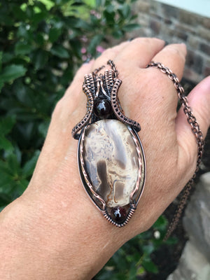 Petrified Palm Wood Oval with Garnets in Antiqued Copper