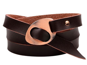 A leather men's accessory cuff bracelet that comes in either reddish-brown or black, with a tarnished or silver clasp.