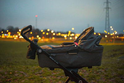 Baby bassinet against an urban background