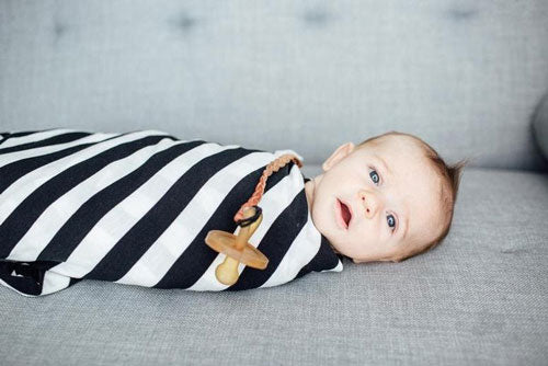 baby in a striped swaddle