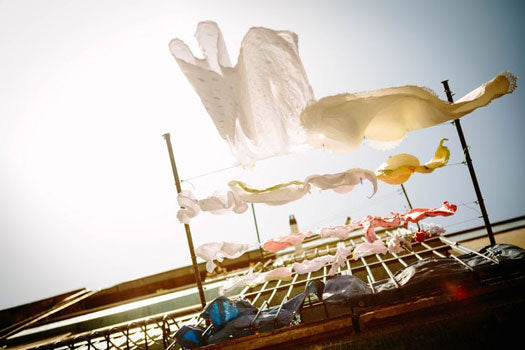 drying clothes hang from a clothesline