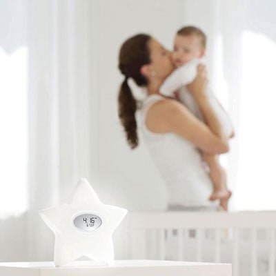 The serenity star, a 5-in-1 baby clock by aden + anais brand