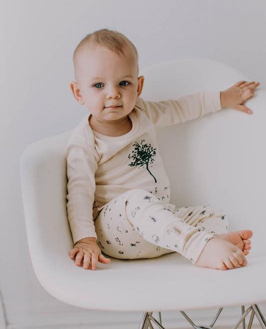 a toddler wearing an organic cotton outfit