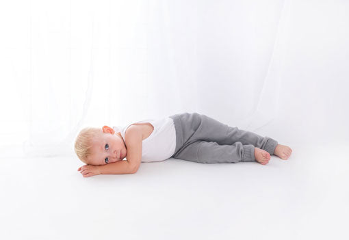 A young boy lays on his side