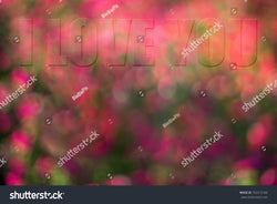 A subtle message of I Love You blends together on colorful bokeh background.