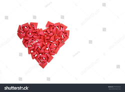 Beautiful cluster of small red paper hearts come together to form a large heart of love.