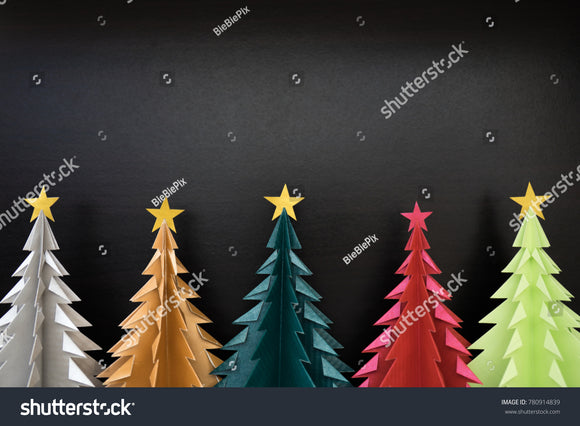 Colorful Origami Christmas Trees with black wooden background.