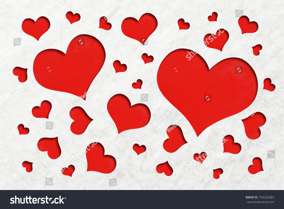 Lovely red heart shape background cuts out of an off white grain paper.