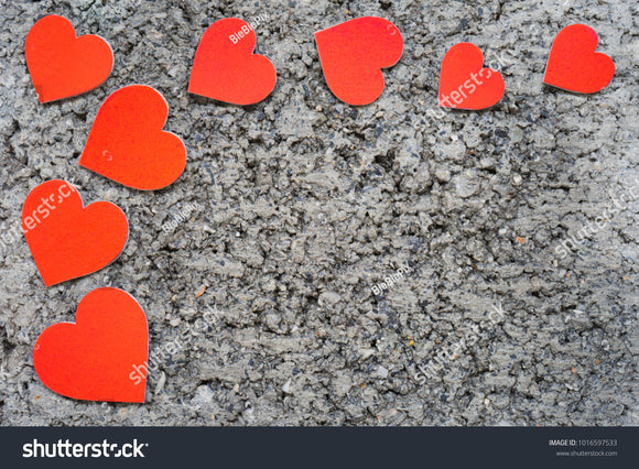 Red hearts on a brick stone background.
