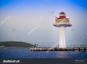 The lighthouse with beautiful blue sky background at the jetty.