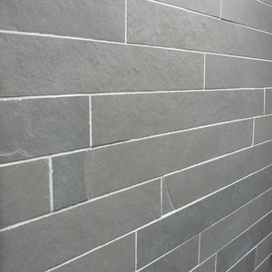 Slate Strips Tiled Fireplace Chamber