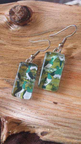 Kereru Earrings on mustard sky