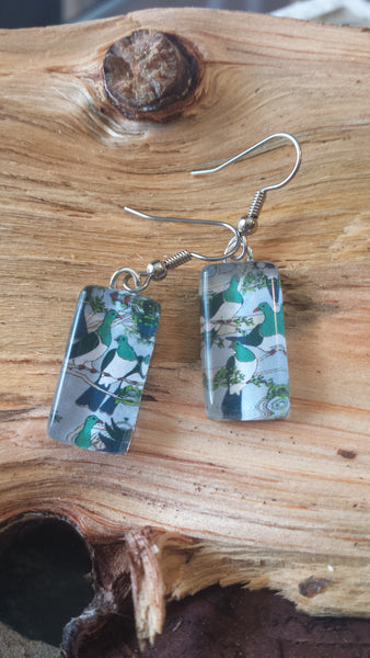 Kereru Earrings on lavender sky