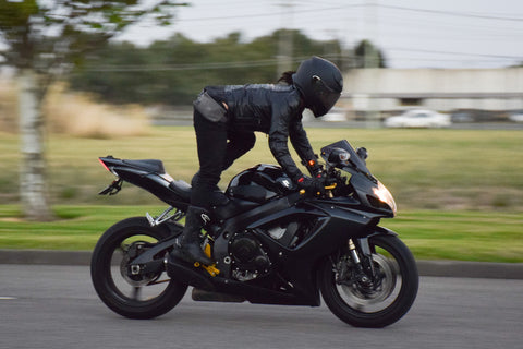 Standing on black motorcycle
