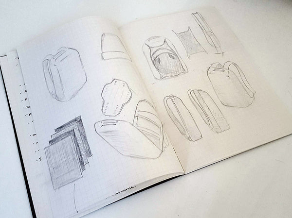 Flying Solo Gear Co motorcycle backpack sketches in a notebook