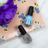 China Glaze Chalk Me Up Pale Sky Blue Creme shade in 14ml, seal with China Glaze Patent Leather Top Coat