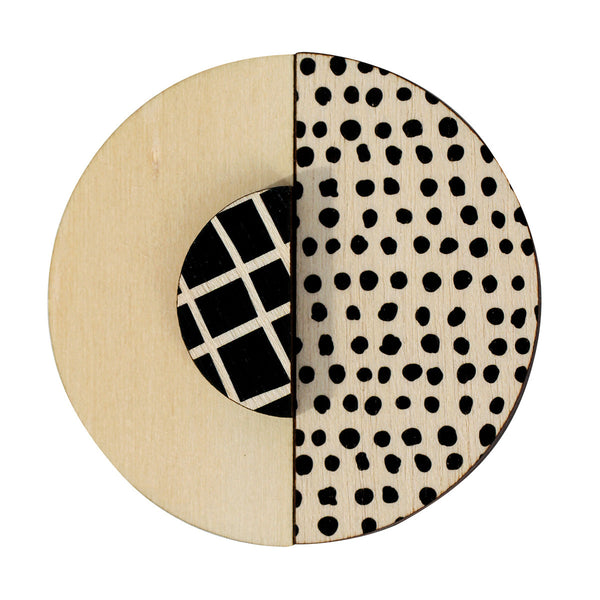 Black spots and lines brooch
