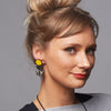 3 tiered wooden city earrings with yellow and black
