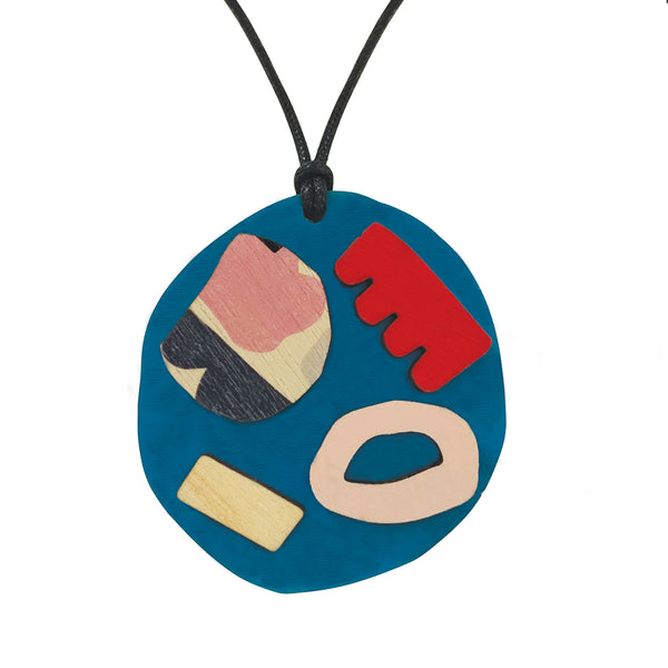 Abstract pendant on blue