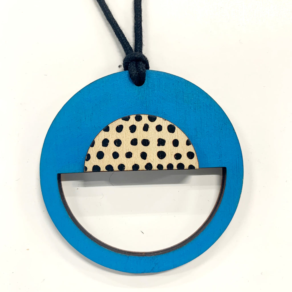 Circle Pendant with blue and black spots