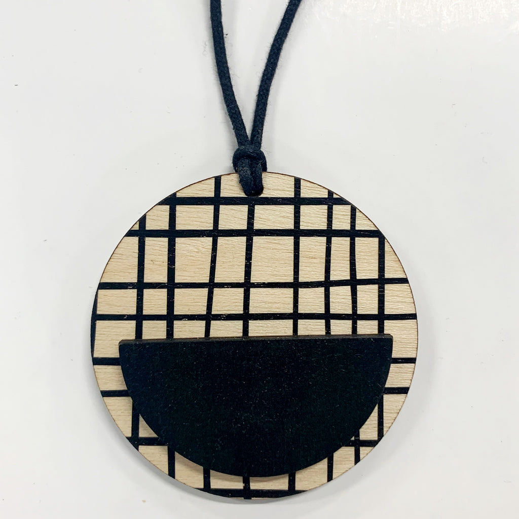 Circle Pendant in black crosses and black